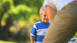 Young boy playing ball with his father Footage
