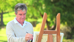 Mature man painting Footage