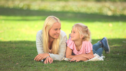 Young girl talking with her mother Footage