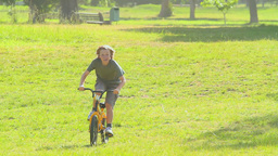 Young boy cycling Footage