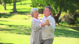 Mature couple dancing outside Footage