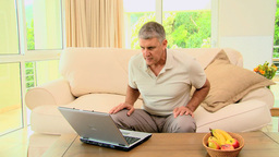 Man delighted with something on laptop Footage