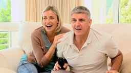 Couple excitedly watching sports on tv Footage