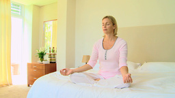 Woman doing the lotus position Footage