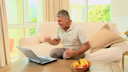 Man winning something on his laptop Footage
