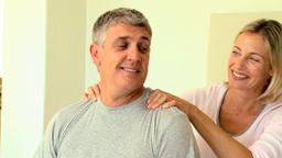 Woman massaging her husbands shoulders Footage