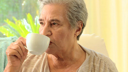 Pensive mature woman drinking tea Footage