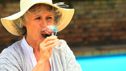 Woman tasting red wine outdoors Footage