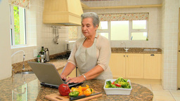 Mature woman looking up a new recipe Footage