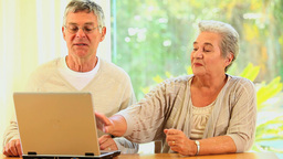 Elderly couple using a laptop Footage