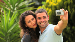 Young couple taking picture of themselves Footage