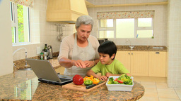 Woman teaching grandson to cook Live Action