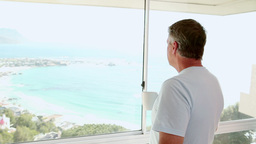Mature man looking out at the beach Footage