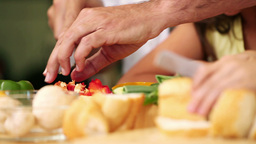 Sandwich and fillings getting sliced Stock Video Footage