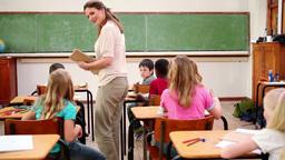 Teacher handing out homeworks Footage