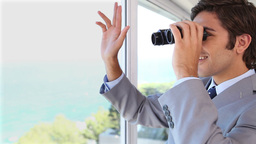 Businessman Businessman Looking Through Binoculars stock footage