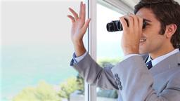Businessman businessman looking through binoculars while waving Live Action