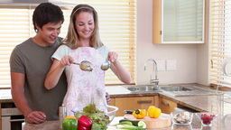 A housewife mixing a salad Footage