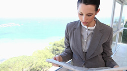 A businesswoman reading a newspaper Footage