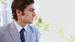 A businessman next to a window Footage