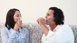 Couple clinking glasses of sparkling wine Footage