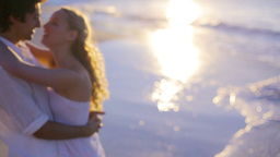 Side View Of Couple Kissing On The Beach During Su stock footage