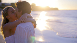 Couple turning and kissing during the sunset at th Footage