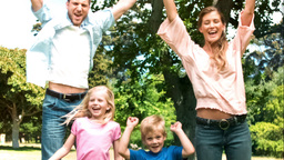Family jumping together in slow motion Footage
