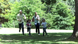 Family running in slow motion together Footage
