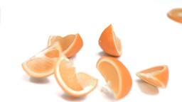 Orange falling into pieces in super slow motion Live Action