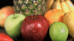 Water raining on fruits in super slow motion Live Action