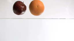 Fruits dropping into water in super slow motion Footage