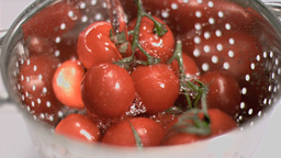 Tomatoes being washed in super slow motion Footage