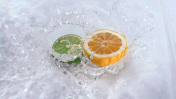 Fruits falling into water in super slow motion Footage