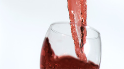 Red wine being poured in super slow motion Footage