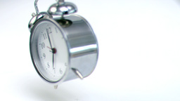 Alarm clock falling down in super slow motion Footage