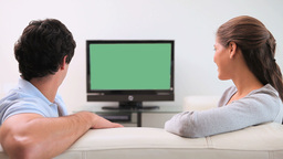 Couple looking at the television screen Footage