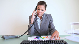 Businesswoman answering the phone Footage
