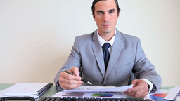 Businessman working on statistics Footage