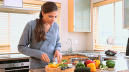 Brunette woman cooking Footage