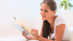 Brunette woman reading a book Footage
