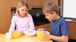 Happy children eating their breakfast Footage