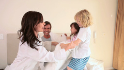 Smiling family having a pillow fight Footage