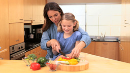 Mother and daughter cooking together Footage