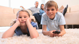 Children watching the television with their parent Footage