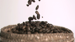 Coffee beans falling in super slow motion Live Action