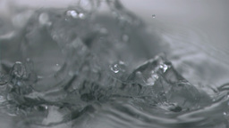 Cube falling in super slow motion in water Live Action