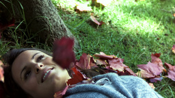 Brunette lying on grass in slow motion Footage