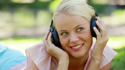 Close up of a woman listening to music and moving  Footage