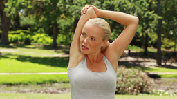 Woman stretching her arms and then looking at the  Footage